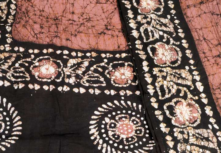Cotton batik mauve black circles